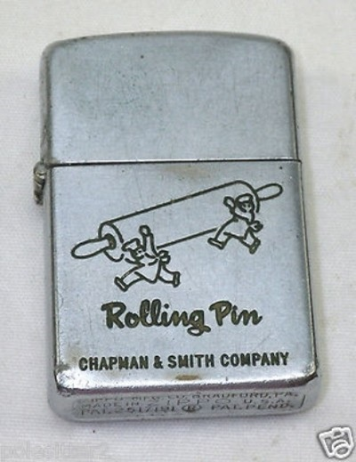 Zippo cigarette lighter made of steel and dates to 1953, according to the markings on bottom. This lighter is an advertising premium from Rolling Pin, Chapman and Smith Company, located in Melrose Park Illinois in the 1940's and 1950's.